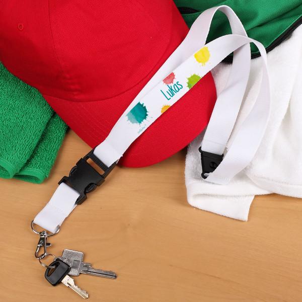 Weißes Schlüsselband mit bunten Farbklecksen