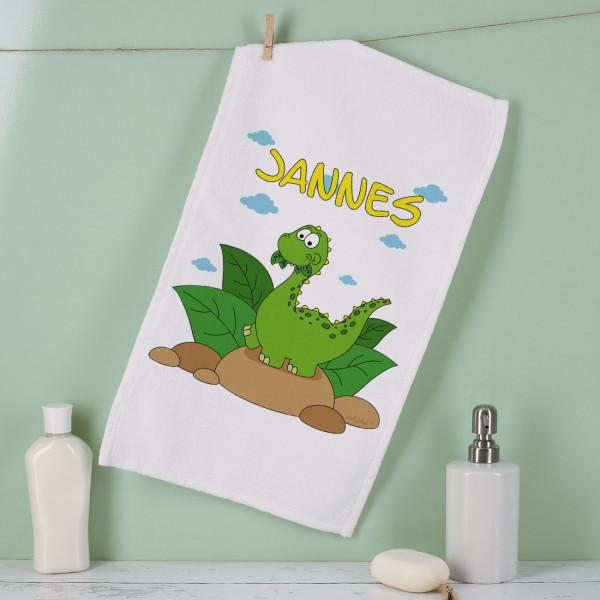 kleines Handtuch mit niedlichem Dino bedruckt