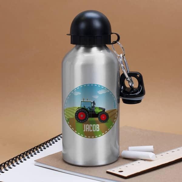 Silberne Trinkflasche mit Treckermotiv und Ihrem Wunschnamen