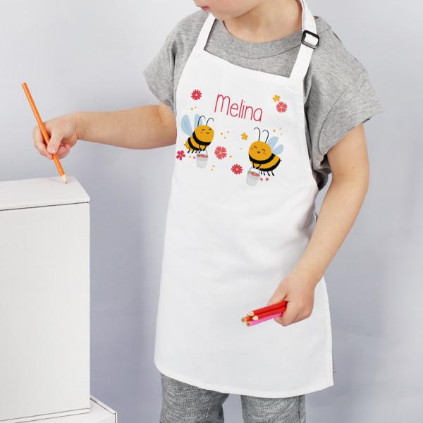Kinderschürze in Weiß mit Bienchen Motiv und Name bedruckt